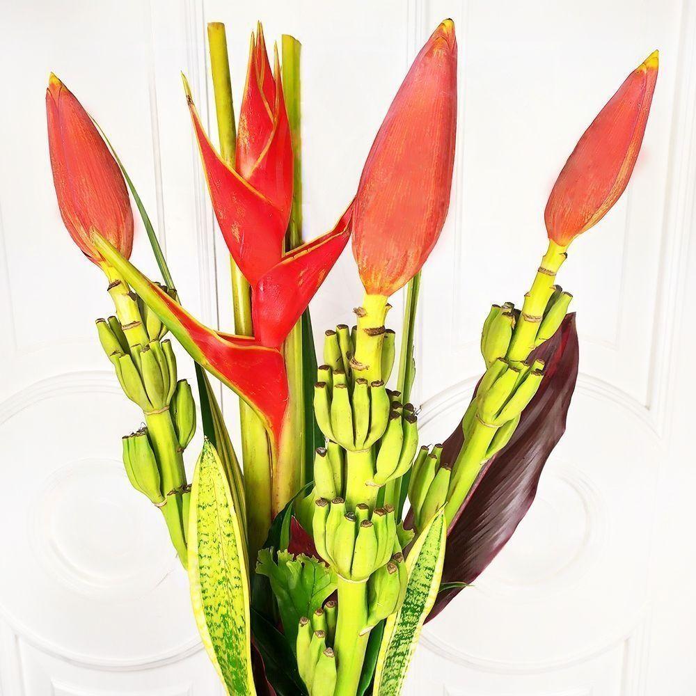 Букет 3 цветка банана с геликонией и тропической зеленью
