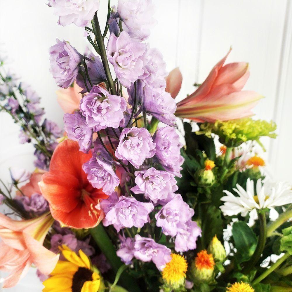 Букет подсолнухов с орхидеями, ромашками и амариллисами